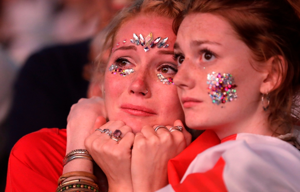England soccer fans react after England lost the semifinal match between Croatia and England at the 2018 soccer World Cup, in Hyde Park, London, Wednesday, July 11, 2018. (AP Photo/Matt Dunham)
