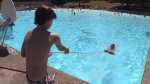 A junior lifeguard in training practices water safety techniques at the New Brighton pool in Vancouver. (CTV)
