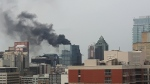 A fire broke out Friday afternoon in downtown Montreal (photo: Twitter / @AnneLaur)