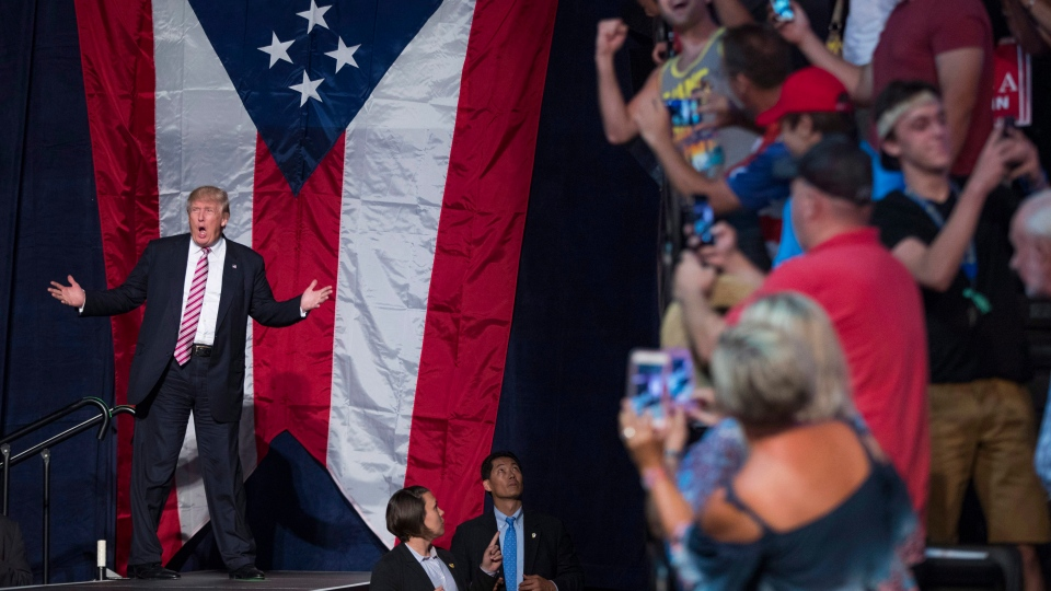 In this July 27, 2016, file photo, Republican presidential nominee Donald Trump arrives for a campaign rally in Toledo, Ohio. (AP Photo/Evan Vucci, File)