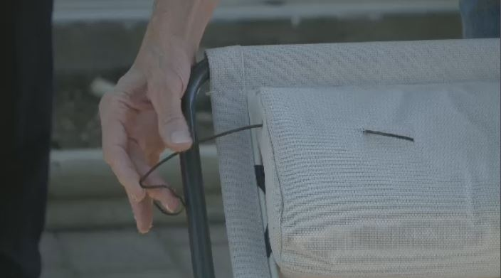 A Regina man was injured after a piece of a flag hit his chair