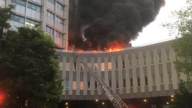 A fire broke out at McGill University's McIntyre Medical Building on Friday, July 13, 2018. The blaze happened just a few hours after another large blaze in the area at the Bell Media Tower. (Source: Twitter, Michael Hendricks)