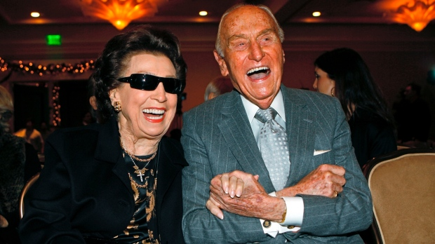 In this Dec. 12, 2007 file photo, Nancy Sinatra Sr. smiles with Paramount Pictures producer A.C. Lyles, as they attend the unveiling of a 10-ft. image of the Frank Sinatra commemorative postal stamp that will be issued by the United States Postal Service, during a ceremony commemorating Frank Sinatra's 92nd birthday, in Beverly Hills, Calif.  (AP Photo/Damian Dovarganes, File)