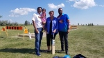 Paramjit Shahi, Councillor Janice Lukes and Manoj Chaudhari pose in front of construction of cricket grounds at La Barrière Park. (Dan Timmerman/CTV Winnipeg)