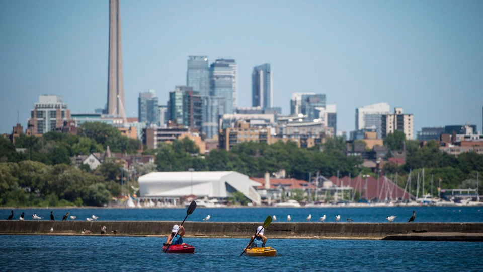 In this file photo, people kayak Lake Ontario near Sir Casimir Gzowski Park in Toronto on Friday, July 6, 2018. THE CANADIAN PRESS/Tijana Martin