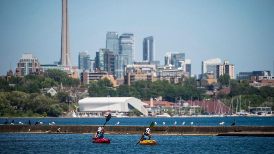 In this file photo, people kayak Lake Ontario near Sir Casimir Gzowski Park in Toronto on Friday, July 6, 2018. THE CANADIAN PRESS/Tijana Martin