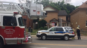 Firefighters put out blaze and rescue one person from rooming house at 26 Ross Street in Barrie on Saturday July 14, 2018. (CTV News/Don Wright)