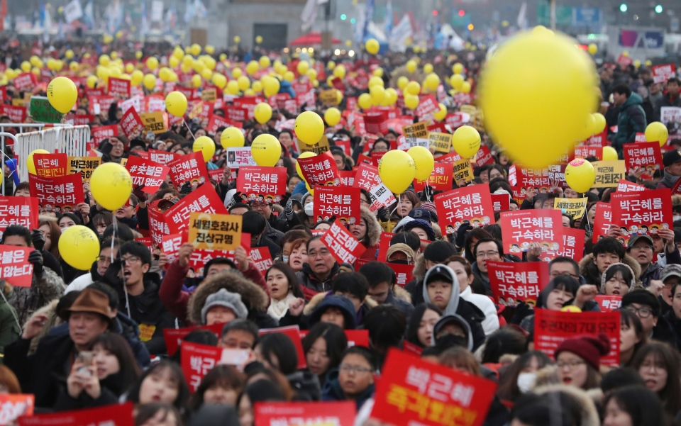 In this Dec. 17, 2016 file photo, protesters shout slogans during a rally against the impeached South Korean President Park Geun-hye in downtown Seoul, South Korea. (AP Photo/Lee Jin-man)