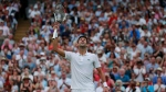 Novak Djokovic of Serbia celebrates defeating Rafael Nadal of Spain in the men's singles semifinal match at the Wimbledon Tennis Championships, in London, Saturday July 14, 2018. (Andrew Couldridge, Pool via AP)