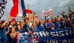 France fans celebrate in Red Square on the eve of the final soccer match Croatia and France during the 2018 soccer World Cup in Moscow, Russia, Saturday, July 14, 2018. (AP Photo/Alexander Zemlianichenko)