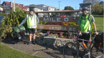 "Skyler Roberts poses for a photo at ""mile zero"" before embarking on his cross-Canada bike ride for Alzheimer's."