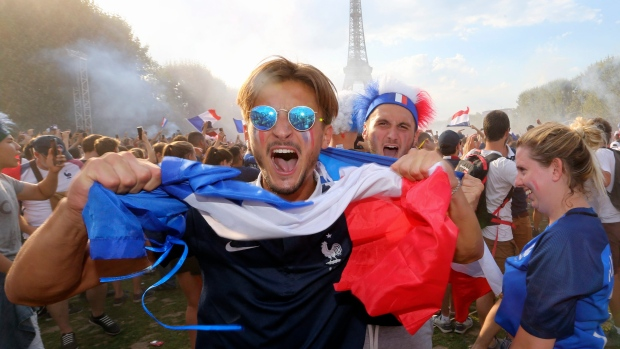 Supporters of the French soccer team celebrate after France won the World Cup final between France and Croatia, Sunday, July 15, 2018 on the Champ de Mars in Paris. France won its second World Cup title by beating Croatia 4-2 . (AP / Bob Edme)