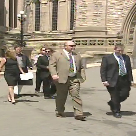 A delegation of business people from Cornwall, Ont. demanded action from the federal government on resolving a border dispute over arming border guards on Cornwall Island, Wednesday, June 17, 2009.