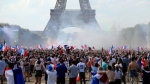Supporters of the French soccer team react as they watch the World Cup final between France and Croatia, Sunday, July 15, 2018 on the Champ de Mars next to the Eiffel Tower in Paris. (AP / Bob Edme)