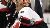 Ottawa Senators goaltender Ray Emery watches members of the Anaheim Ducks celebrate their 6-2 victory to win the Stanley Cup Finals Wednesday, June 6, 2007 in Anaheim. (CP / Paul Chiasson)