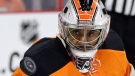 Philadelphia Flyers' Ray Emery watches a deflected shot fly by during the first period of an NHL hockey game against the Boston Bruins, Saturday, Jan. 10, 2015, in Philadelphia. Boston won 3-1. (AP Photo/Matt Slocum)
