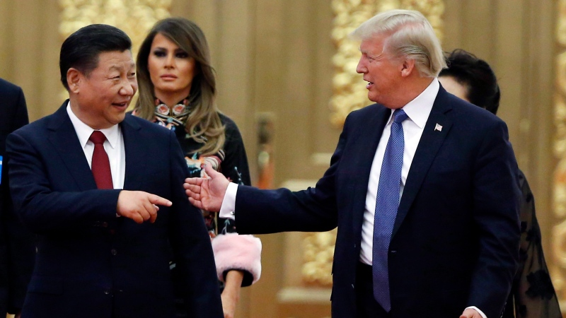 U.S. President Donald Trump China's President Xi Jinping arrive for the state dinner with the first ladies at the Great Hall of the People in Beijing, China on Nov. 9, 2017. (Thomas Peter/The Canadian Press/AP)