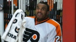 Philadelphia Flyers goalie Ray Emery looks up at the scoreboard after he was replaced by Steve Mason during the third period of an NHL hockey game against the Chicago Blackhawks Wednesday, Dec. 11, 2013, in Chicago. (AP Photo/Charles Rex Arbogast)