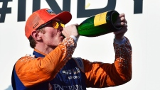 Scott Dixon sips champagne after winning the Honda Indy in Toronto on Sunday, July 15, 2018. THE CANADIAN PRESS/Frank Gunn