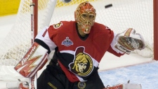 Ottawa Senators goalltender Ray Emery keeps a close eye on the puck during third period NHL Stanley Cup game 3 action against the Anaheim Ducks in Ottawa on Saturday June 2, 2007. (CP / Tom Hanson)