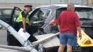 Crash topples traffic light, damages cars