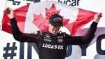 Robert Wickens celebrates his third place finish at the Honda Indy in Toronto on Sunday, July 15, 2018. THE CANADIAN PRESS/Frank Gunn