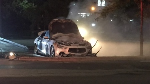 A suspicious vehicle fire destroyed a Maserati at a Toronto parking lot. (Mike Nguyen / CP24)