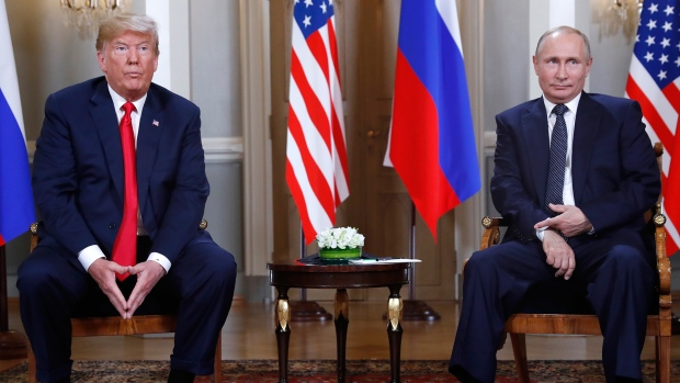 U.S. President Donald Trump, left, and Russian President Vladimir Putin sit on their chairs at the beginning of a one-on-one meeting at the Presidential Palace in Helsinki, Finland, Monday, July 16, 2018. (AP / Pablo Martinez Monsivais)