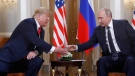 U.S. President Donald Trump, left, and Russian President Vladimir Putin shake hand at the beginning of a meeting at the Presidential Palace in Helsinki, Finland, Monday, July 16, 2018. (AP / Pablo Martinez Monsivais)