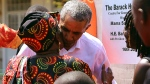 Former U.S. President Barack Obama greets his step- grandmother Sarah Obama, during an event in Kogelo, Kisumu, Kenya, Monday, July 16, 2018. (AP Photo Brian Inganga)