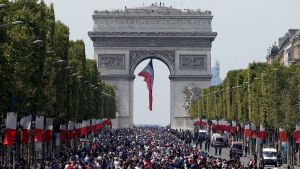 The crowd gathers to welcome the French soccer team for a parade a day after the French team victory in the soccer World Cup, Monday, July 16, 2018 in Paris. (AP Photo/Thibault Camus)