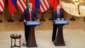 U.S. President Donald Trump, left, and Russian President Vladimir Putin attend a press conference after the meeting of U.S. President Donald Trump and Russian President Vladimir Putin at the Presidential Palace in Helsinki, Finland, Monday, July 16, 2018. (AP Photo/Markus Schreiber)