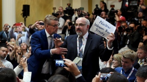 Security removes an apparent protester before a joint press conference between U.S. President Donald Trump and Russia President Vladimir Putin in the Presidential Palace in Helsinki, Finland, Monday, July 16, 2018. (Antti Aimo-Koivisto/Lehtikuva via AP)