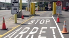 This Aug. 2, 2017 file photo shows the U.S. border crossing post at the Canadian border between Vermont and Quebec, Canada, at Beecher Falls, Vt. For the first time in decades, one of the world's most durable and amicable alliances faces serious strain as Canadians _ widely seen as some of the nicest, politest people on Earth _ absorb Donald Trump's insults against their prime minister and attacks on their country's trade policies. (AP Photo/Wilson Ring)