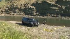 TSB investigators collect evidence from the site of a helicopter crash southeast of Calgary on Monday, July 16, 2018.