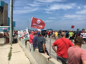 Union members gather at the entrance of the Compass Minerals salt mine in Goderich awaiting the results of a vote held Monday, July 16, 2018 on a tentative contract.