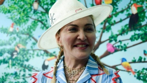 Madonna speaks to the press at a news conference in Blantyre, Malawi, Monday, July 16, 2018. (AP Photo/Thoko Chikondi)