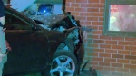 Teen slams into building