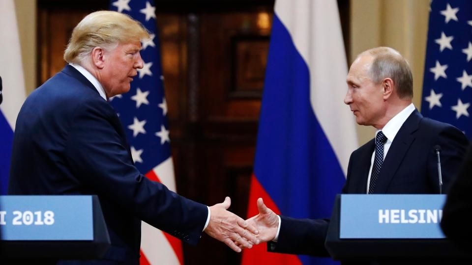 U.S. President Donald Trump shakes hand with Russian President Vladimir Putin in Helsinki, Finland, July 16, 2018. (AP Photo/Alexander Zemlianichenko)