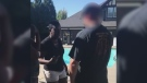 Guerda Henry, left, is seen at the pool of her Surrey townhouse complex in this Facebook video she posted on July 13, 2018.