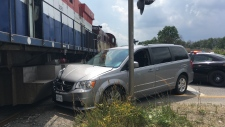 A van collided with a train