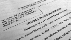Court papers unsealed Monday, July 16, 2018, photographed in Washington, shows part of the criminal complaint against Maria Butina. She was arrested July 15, on a charge of conspiracy to act as an unregistered agent of the Russian government. (AP Photo/Jon Elswick)