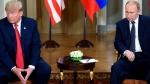 U.S. President Donald Trump, left and Russian President Vladimir Putin gesture during their meeting in the Presidential Palace in Helsinki, Monday, July 16, 2018. (Heikki Saukkomaa/Lehtikuva via AP)