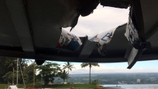 This photo provided by the Hawaii Department of Land and Natural Resources shows damage to the roof of a tour boat after an explosion sent lava flying through the roof off the Big Island of Hawaii Monday, July 16, 2018, injuring at least 23 people. (Hawaii Department of Land and Natural Resources via AP)