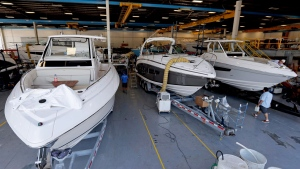 Boats near completion are lined up at Regal Marine Industries in Orlando, Fla., Wednesday, July 11, 2018. Some U.S. manufacturers are feeling the impact of tariffs of up to 25 percent that the Trump administration has imposed on thousands of products imported from China, Europe, Mexico, Canada, India and Russia, and of retaliatory tariffs that countries have put on U.S. exports. Among the products the U.S. has targeted are aluminum, steel and goods made from those metals, vehicles and their components and computer parts. The retaliation has hit U.S. makers of food and farm products, alcoholic beverages and boats and other vehicles. (AP / John Raoux)