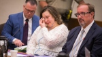 Nataliia Karia, center, with her lawyers Brock Hunter, right, and Ryan Else, reacts during her sentencing hearing in Hennepin County District Court in Minneapolis, Monday, July 16, 2018. (Leila Navidi/Star Tribune via AP)