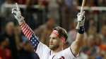 Washington Nationals Bryce Harper signals to the crowd as he walks back to the dugout during the MLB Home Run Derby, at Nationals Park, Monday, July 16, 2018 in Washington. (AP Photo/Alex Brandon)