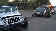 An SUV with significant damage to its front end is towed from a location in Forest Lawn following a Monday night crash with a Jeep