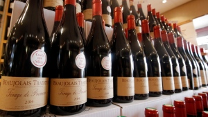 In this Nov. 20, 2014, file photo, bottles of Beaujolais Nouveau wine are displayed in a wine store at Issy Les Moulineaux, outskirts of Paris. (AP Photo/Francois Mori, File)