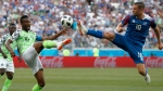 In this Friday, June 22, 2018 file photo Nigeria's John Obi Mikel, left, and Iceland's Gylfi Sigurdsson compete for the ball during the group D match between Nigeria and Iceland at the 2018 soccer World Cup in the Volgograd Arena in Volgograd, Russia. (AP Photo/Darko Vojinovic, File)